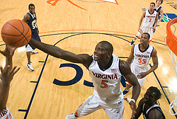 Virginia center Assane Sene (5) grabs a rebound in action against Shepherd.  The Virginia Cavaliers defeated the Shepherd Rams 87-52 in an NCAA basketball exhibition game at the University of Virginia's John Paul Jones Arena in Charlottesville, VA on November 9, 2008.