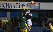 Steve Morison and Benjamin Buchel in an ariel battle during the Johnstone's Paint Trophy semi final first leg match between Millwall and Oxford United at The Den, London, England on 14 January 2016. Photo by Michael Hulf.