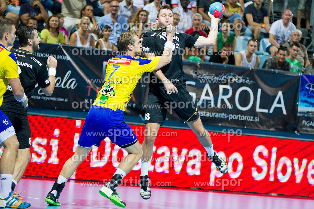 Povilas Babarskas #7 of RK Celje Pivovarna Lasko and Michal Szyba #18 of RK Gorenje Velenje during handball match between RK Celje Pivovarna Lasko vs RK Gorenje Velenje of Super Cup 2015, on August 29, 2015 in SRC Marina, Portoroz / Portorose, Slovenia. Photo by Urban Urbanc / Sportida