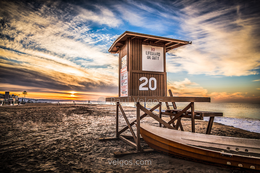 HDR Photo of lifeguard tower 20 during sunrise on Balboa Peninsula beach in Newport Beach California.  Newport Beach is  located in Orange County in Southern California along the Pacific Ocean.