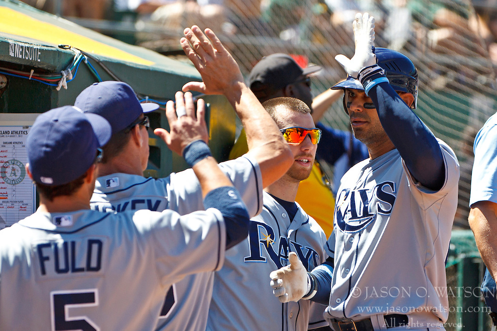 OAKLAND, CA - AUGUST 01: Carlos Pena #23 of the Tampa Bay Rays is congratulated by teammates after hitting a home run against the Oakland Athletics during the eighth inning at O.co Coliseum on August 1, 2012 in Oakland, California. The Tampa Bay Rays defeated the Oakland Athletics 4-1. (Photo by Jason O. Watson/Getty Images) *** Local Caption *** Carlos Pena