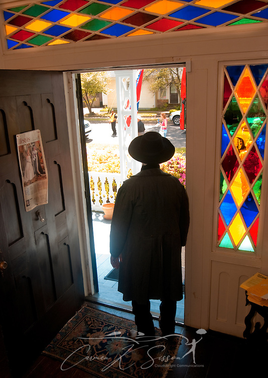 Homeowner Sid Caradine, dressed in period costume, is silhoutted as he gazes out the door of the Amzi Love Home in Columbus, Miss. April 17, 2010. The 1848 home, which has been featured in Fodor's Travel Guide and The New York Times Travel Magazine, was among nearly two dozen on tour during Columbus' annual Spring Pilgrimage. (Photo by Carmen K. Sisson/Cloudybright)