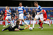 Queens Park Rangers goalkeeper Alex Smithies (25) comes off his line to collect the ball during the Sky Bet Championship match between Queens Park Rangers and Charlton Athletic at the Loftus Road Stadium, London, England on 9 April 2016. Photo by Andy Walter.