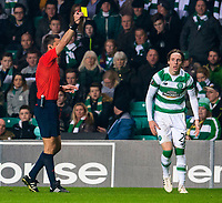05/11/15 UEFA EUROPA LEAGUE GROUP STAGE<br /> CELTIC v MOLDE FK<br /> CELTIC PARK - GLASGOW<br /> Celtic's Stefan Johansen (right) is shown a yellow card which rules him out of his side's next Europa League match against Ajax
