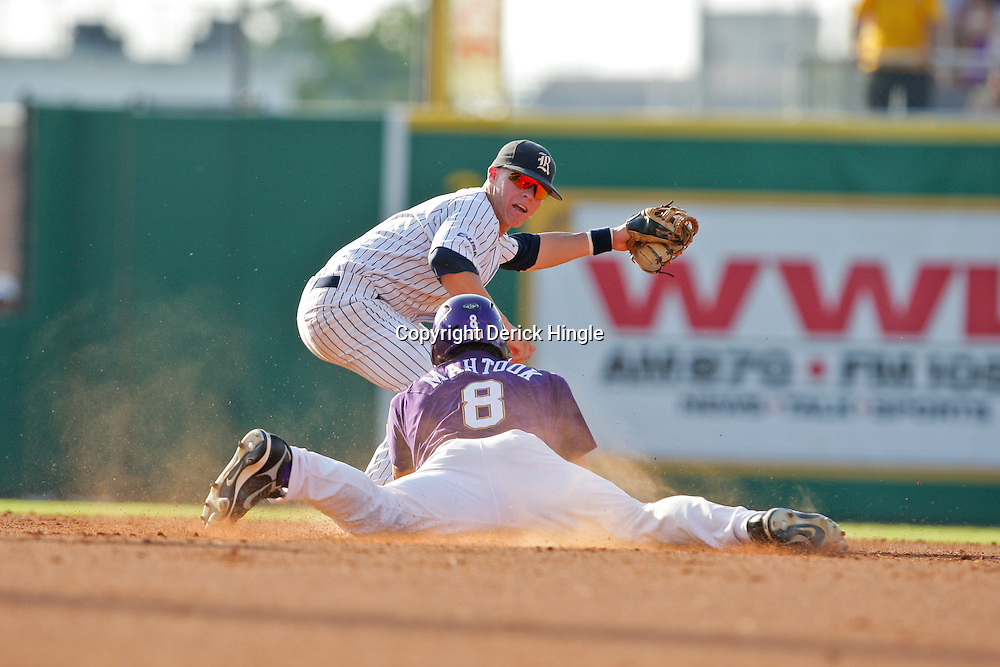 06 June 2009:  Mikie Mahtook (8) slides in to second ahead of the tag of Rick Hague of Rice during a 5-3 victory by the LSU Tigers over the Rice Owls in game two of the NCAA baseball College World Series, Super Regional played at Alex Box Stadium in Baton Rouge, Louisiana. The Tigers with the win advance to next week's College Baseball World Series in Omaha, Nebraska.
