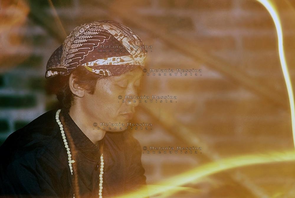 Indonesia, Java island; meditation of Pak Iman before starting  the ritual of the Kris..Indonesia, isola di Giava; meditazione del dukùn Pak Iman prima di dare inizio al rituale del kris.