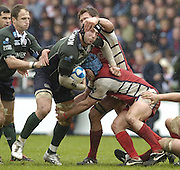 Twickenham, ENGLAND, Gloucester's, James Forrester and Andy Hazell get a grip on the Exiles No. 8 Juan Leguizamon during the  European Challenge Cup, Gloucester Rugby vs London Irish, at the Twickenham Stoop, 21.05.2006. © Peter Spurrier/Intersport-images.com,  / Mobile +44 [0] 7973 819 551 / email images@intersport-images.com.   [Mandatory Credit, Peter Spurier/ Intersport Images].