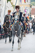 Sinjska Alka, in the town of Sinj, Croatia (4 August 2013). Now in its 298th year, the Alka is a knightly tournament dating back to 1715, in which riders compete to spear a small metal ring from a galloping horse. The Alka is inscribed on the UNESCO list of Intangible Cultural Heritage. Pictured here, Ante Zorica, winner of the 298th Sinjska Alka.