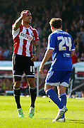 Andre Grey goal celebration scoring Brentfords first during the Sky Bet Championship match between Brentford and Nottingham Forest at Griffin Park, London, England on 6 April 2015. Photo by Matthew Redman.