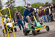 "Charlie Kienbaum, 16, of Spirit Lake flies off the line in a qualifying drag in his racing lawnmower, ""Hopgrasser"" during Sunday's 10th Annual Big Back-In in Spirit Lake."