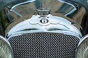 Vintage Bentley four and a half litres luxury car built in 1929 with AA -Automobile Association - RAC - Royal Automobile Club - and Bentley Drivers Club badges, headlamps, radiator grill and logo