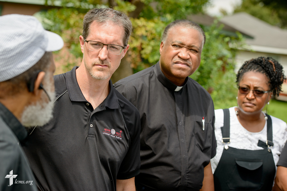 The Rev. Dr. Steve Schave, director of LCMS Urban & Inner City Mission and director of LCMS Church Planting, the Rev. Dr. Roosevelt Gray Jr., director of LCMS Black Ministry, and Nicole Ridley, chief executive of LCMS National Housing Support Corporation, talk to an LCMS pastor who suffered flood-damage in his home from Hurricane Harvey on Tuesday, Sept. 26, 2017, in Houston. LCMS Communications/Erik M. Lunsford