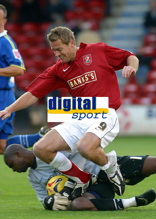 Photo: Dave Linney.<br />Walsall v Torquay United. Coca Cola League 2. 04/11/2006 Walsall's .Martin Butler(R) is folied by keeper Nathan Abbey