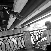 A homeless man climbs under a bridge frequently used by intravenous drug users in Haiphong. Vietnam has an estimated 200 000 people living with HIV.