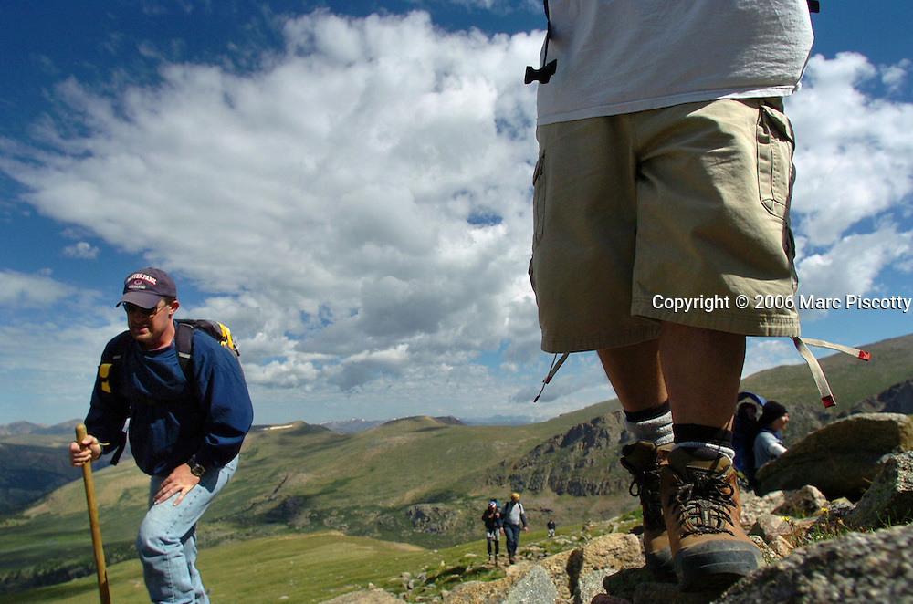 """(GEORGETOWN, Co., SHOT 8/11/2004).About 35 members of the Denver Rescue Mission's """"New Life"""" rehabiliatation program climbed to the more than 14,000 foot peak of Mount Bierstadt near Georgetown, Co. Wednesday. Two of the members climbing to the top were Justin Cottrell (left), 32, of Denver and Aaron Pytko, 32, of Conifer. Cottrell has been in the program 31 days and Pytko has been in the program for six months. Both are in the program at the Rescue Mission's Farm location in Wellington, Co. The """"New Life"""" program is a long term Christian based recovery program that gives the men involved the tools to become self-sufficient and overcome various addictions. The climb helps the men to set a goal and achieve it and is part of the program..(Photo by Marc Piscotty/ © 2004)"""
