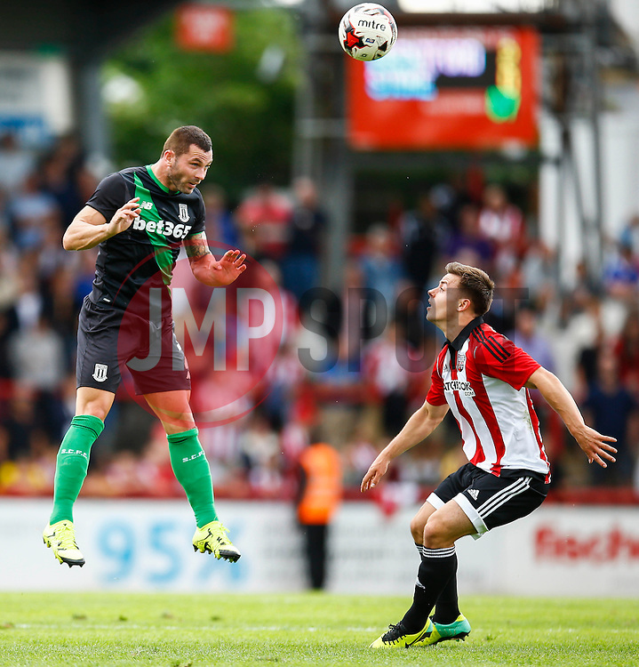 Phillip Bardsley of Stoke City jumps for the header - Mandatory by-line: Jason Brown/JMP - Mobile 07966 386802 25/07/2015 - SPORT - FOOTBALL - Brentford, Griffin Park - Brentford v Stoke City - Pre-Season Friendly