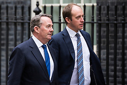 London, UK. 4th December, 2018. Liam Fox MP (l), Secretary of State for International Trade and President of the Board of Trade, arrives at 10 Downing Street for a further meeting following a Cabinet meeting on the day on which MPs will begin to debate Prime Minister Theresa May's Brexit agreement in the House of Commons.