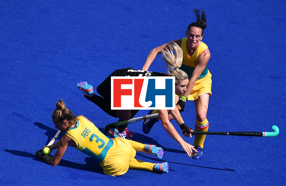 TOPSHOT - Australia's Brooke Peris and Australia's Madonna Blyth (R) vie with New Zealand's Sophie Cocks (C) during the the women's quarterfinal field hockey New Zealand vs Australia match of the Rio 2016 Olympics Games at the Olympic Hockey Centre in Rio de Janeiro on August 15, 2016. / AFP / MANAN VATSYAYANA        (Photo credit should read MANAN VATSYAYANA/AFP/Getty Images)
