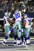 Dallas Cowboys running back Darren McFadden (20) leaps onto a pile of teammates including Cowboys center Travis Frederick (72) and Cowboys offensive tackle Chaz Green (79) after Dallas Cowboys tight end Jason Witten (82) catches a 10 yard touchdown pass for a 10-6 second quarter Cowboys lead during the 2017 NFL week 3 preseason football game against the Oakland Raiders, Saturday, Aug. 26, 2017 in Arlington, Tex. The Cowboys won the game 24-20. (©Paul Anthony Spinelli)