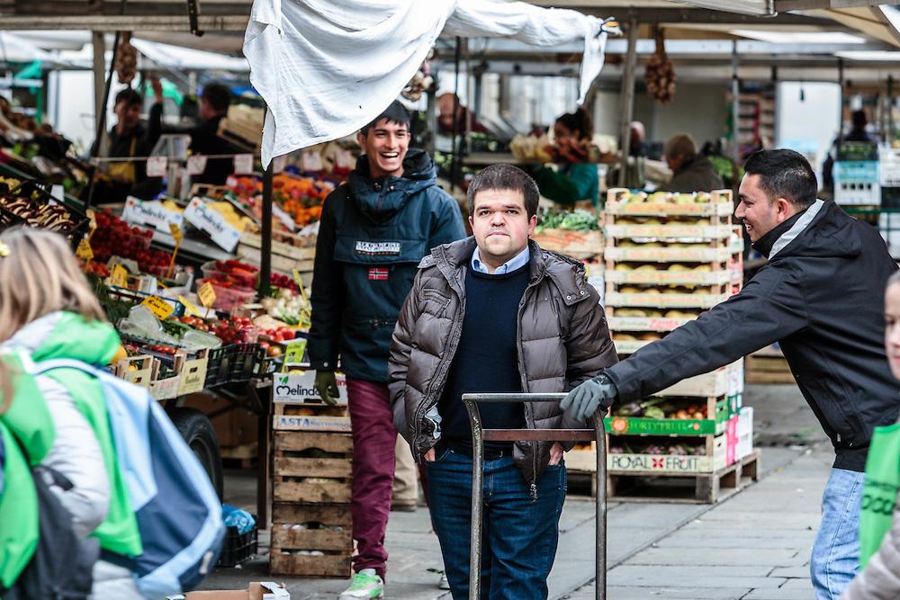 26 FEB 2015 - Padova - Davide Meneghini - che dai 127 ha raggiunto i 157 cm di altezza dopo una serie di operazioni per l'allungamento degli arti - al mercato in piazza delle Erbe.