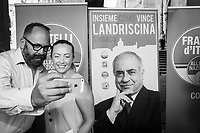 COMO, ITALY - 21 JUNE 2017: Giorgia Meloni (right), leader of the Fratelli d'Italia party, takes a selfie with a supporter at the end of Mr Landriscina's rally in Como, Italy, on June 21st 2017.<br /> <br /> Residents of Como are worried that funds redirected to migrants deprived the town's handicapped of services and complained that any protest prompted accusations of racism.<br /> <br /> Throughout Italy, run-off mayoral elections on Sunday will be considered bellwethers for upcoming national elections and immigration has again emerged as a burning issue.<br /> <br /> Italy has registered more than 70,000 migrants this year, 27 percent more than it did by this time in 2016, when a record 181,000 migrants arrived. Waves of migrants continue to make the perilous, and often fatal, crossing to southern Italy from Africa, South Asia and the Middle East, seeing Italy as the gateway to Europe.<br /> <br /> While migrants spoke of their appreciation of Italy's humanitarian efforts to save them from the Mediterranean Sea, they also expressed exhaustion with the country's intricate web of permits and papers and European rules that required them to stay in the country that first documented them.