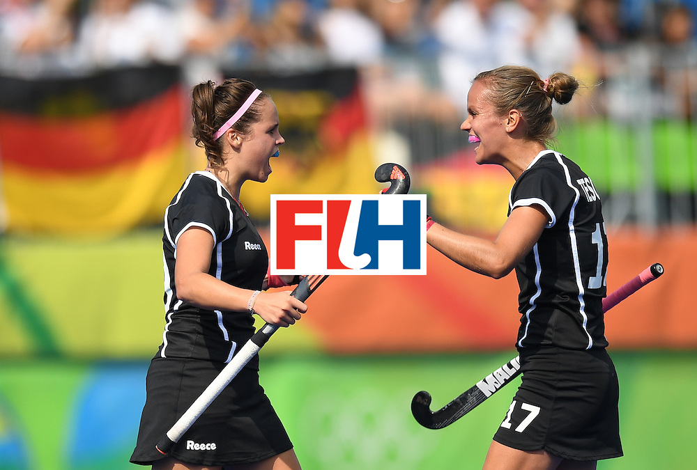 Germany's Pia-Sophie Oldhafer (L) celebrates scoring a goal with Jana Teschke during the women's field hockey New Zealand vs Germany match of the Rio 2016 Olympics Games at the Olympic Hockey Centre in Rio de Janeiro on August, 8 2016. / AFP / MANAN VATSYAYANA        (Photo credit should read MANAN VATSYAYANA/AFP/Getty Images)