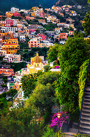 """""""Positano's Church of Santa Maria Assunta illuminated by the evening light""""…<br /> <br /> Taking an evening stroll along the Strada of Positano, the highlight was the majestic evening view of the church of Santa Maria Assunta overlooking the hillside. The colorful dome is made of majolica tiles which are very prominent on the Amalfi Coast, and the church contains a thirteenth-century Byzantine icon of the legendary Black Madonna. All indications seemed to verify that late May in Positano presented a spectacular pallet of every color under God's rainbow. This quaint seaside village stimulated one's senses, aggrandizing its chest and boasting specular perfection. I cannot imagine a more benevolent time of year than during late spring to visit the Bellissimo Amalfi coast. This image was one of my last of the evening before a long hike up to the terrace of Hotel Montemare's famous restaurant. Finally, time to relax and unwind while admiring yet another truly breathtaking sea view of Positano Bay."""