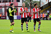 Christy Pym (1) of Exeter City, Jayden Stockley (11) of Exeter City and Troy Brown (39) of Exeter City applaud the fans at full time after their team beat Crewe Alexandra 3-0 during the EFL Sky Bet League 2 match between Exeter City and Crewe Alexandra at St James' Park, Exeter, England on 16 September 2017. Photo by Graham Hunt.
