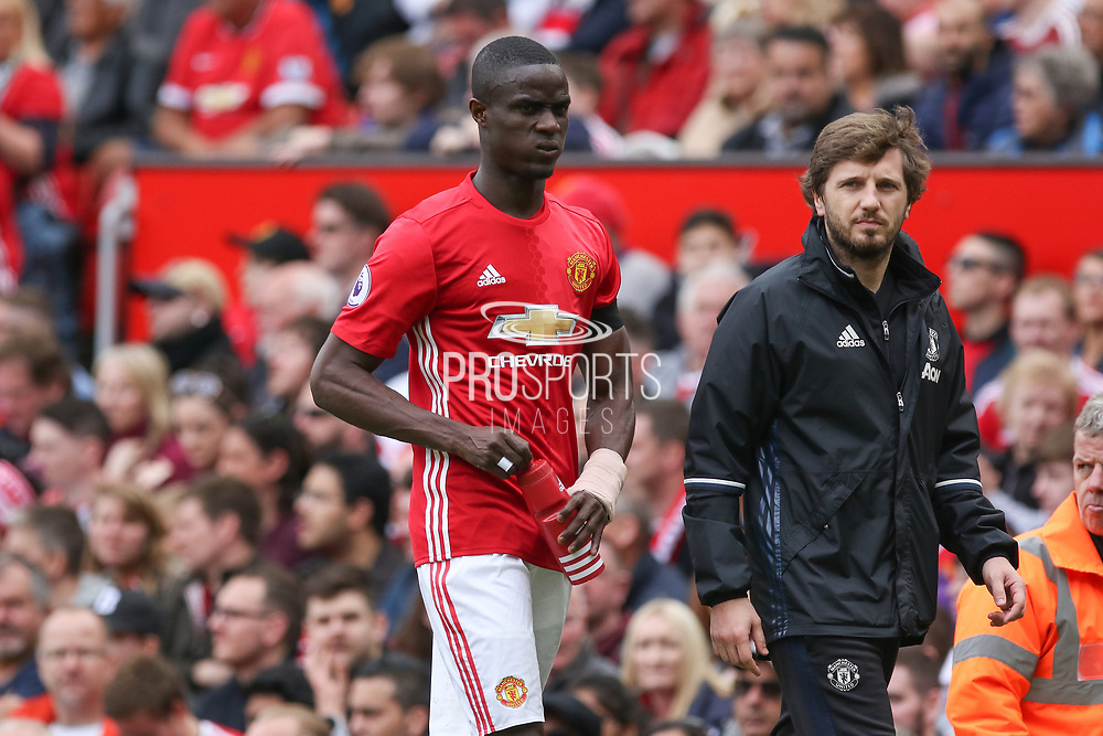 Eric Bailly Defender of Manchester United limps off injured during the Premier League match between Manchester United and Swansea City at Old Trafford, Manchester, England on 30 April 2017. Photo by Phil Duncan.