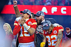 Jan 19, 2020; Kansas City, Missouri, USA; Kansas City Chiefs quarterback Patrick Mahomes (15), tight end Travis Kelce (87) and strong safety Tyrann Mathieu (32) celebrate after beating the Tennessee Titans in the AFC Championship Game at Arrowhead Stadium. Mandatory Credit: Denny Medley-USA TODAY Sports