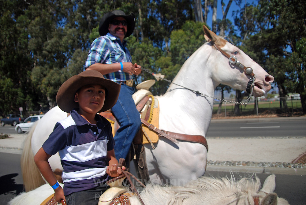 Jesse Tapia rides a miniature horse along North Main Street in the Friday mini-parade, courtesy of the 102nd California Rodeo Salinas, which opened Thursday night, July 19 for a four-day run.