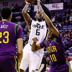 Feb 8, 2017; New Orleans, LA, USA; Utah Jazz forward Joe Johnson (6) shoots over New Orleans Pelicans guard Langston Galloway (10) and forward Anthony Davis (23) during the second half of a game at the Smoothie King Center. The Jazz defeated the Pelicans 127-94.  Mandatory Credit: Derick E. Hingle-USA TODAY Sports