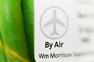"Close up of ""By Air"" logo on packet of green beans in UK Super maket."