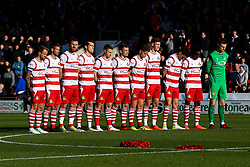 Doncaster Rovers players stand together during a minute silence - Mandatory by-line: Ryan Crockett/JMP - 11/11/2017 - FOOTBALL - The Keepmoat Stadium - Doncaster, England - Doncaster Rovers v Rotherham United - Sky Bet League One