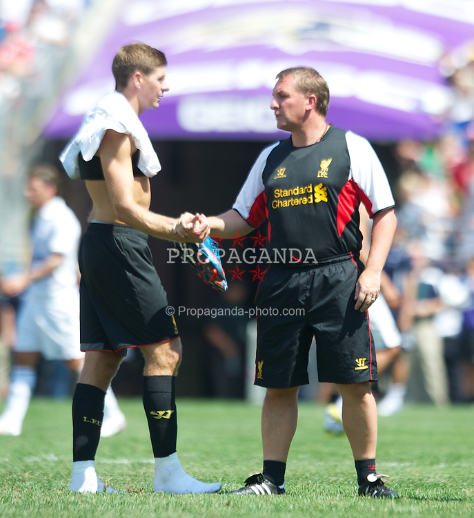 BALTIMORE, MD - Saturday, July 28, 2012: Liverpool manager Brendan Rodgers and captain Steven Gerrard after the goalless draw against Tottenham Hotspur during a pre-season friendly match at the M&T Bank Stadium. (Pic by David Rawcliffe/Propaganda)