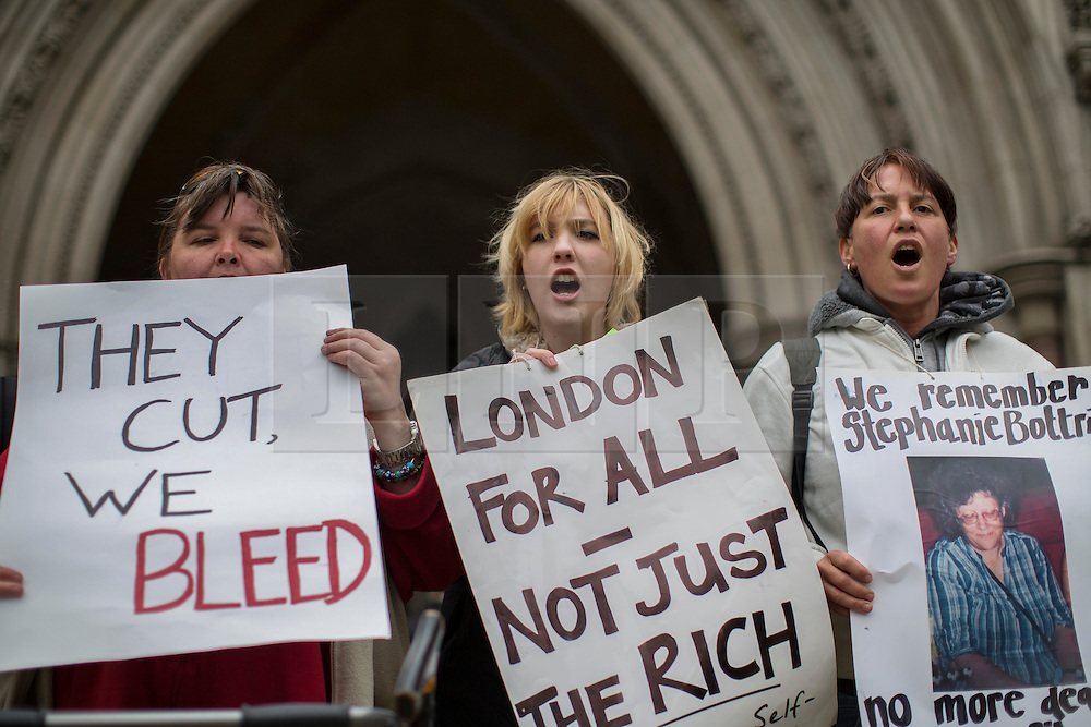 © licensed to London News Pictures. London, UK 15/05/2013.  Demonstrators protest over the government's changes to the welfare system and the proposed 'Bedroom Tax' outside the Royal Courts of Justice to support a number of disabled people and their families who started a legal challenge over the Government's proposed 'Bedroom Tax' . Photo credit: Tolga Akmen/LNP