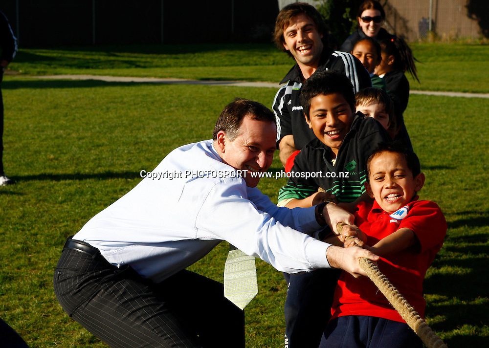 Prime Minister John Key and All Black Conrad Smith participate in a tug of war with the kids, KiwiSport government funding launch to announce direct funding for sport in schools. Bairds Mainfreight Primary School, Otara, Auckland. 11 August 2009. Photo: William Booth/PHOTOSPORT