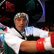 "Guillermo ""El Borrego"" Avila enters the arena for his fight for the WBO Latin Featherweight title during the ""Boxeo Telemundo"" boxing match between at the Kissimmee Civic Center on Friday, March 14, 2014 in Kissimmme, Florida.  Oquendo won the fight by unanimous decision. (AP Photo/Alex Menendez)"