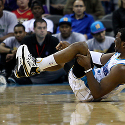 April 3, 2011; New Orleans, LA, USA; New Orleans Hornets point guard Chris Paul (3) grabs his knee in pain after a fall on the court during the second quarter against the Indiana Pacers at the New Orleans Arena.    Mandatory Credit: Derick E. Hingle