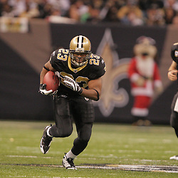 2008 December, 07: New Orleans Saints running back Pierre Thomas (23) runs through a hole in the Falcons defense during a 29-25 victory by the New Orleans Saints over NFC South divisional rivals the Atlanta Falcons at the Louisiana Superdome in New Orleans, LA.