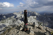 Headstand on Bobotov Kuk, 2522m, Durmitor, Montenegro.