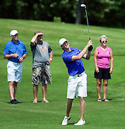 Bill Carlson and spectators watch his approach shot from the seventeenth fairway during the championship match of the North Dakota Match Play golf tournament at Rose Creek Golf Course in Fargo on Sunday, July 20, 2014.<br /> Nick Wagner / The Forum