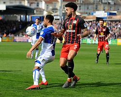 Byron Moore of Bristol Rovers is challenged by Derrick Williams of Blackburn Rovers - Mandatory by-line: Neil Brookman/JMP - 14/04/2018 - FOOTBALL - Memorial Stadium - Bristol, England - Bristol Rovers v Blackburn Rovers - Sky Bet League One