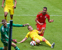 CARDIFF, WALES - Friday, June 5, 2015: Wales' Hal Robson-Kanu is blocked by David Vaughan during a practice match at the Cardiff City Stadium ahead of the UEFA Euro 2016 Qualifying Round Group B match against Belgium. (Pic by David Rawcliffe/Propaganda)