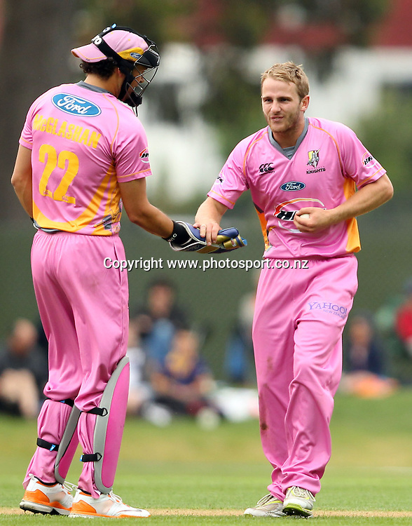 Kane Williamson celebrates taking the wicket of Brendon McCullum with Peter McGlashan.<br /> Twenty20 Cricket - HRV Cup, Otago Volts v Northern Knights, 29 December 2011, University Oval, Dunedin, New Zealand.<br /> Photo: Rob Jefferies/PHOTOSPORT