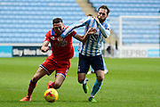 Coventry City midfielder Jim O'Brien and Oldham Athletic midfielder Mike Jones during the Sky Bet League 1 match between Coventry City and Oldham Athletic at the Ricoh Arena, Coventry, England on 19 December 2015. Photo by Alan Franklin.
