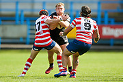Bradford Bulls replacement Sam Hallas (29) is stopped by Oldham Matthew Wilkinson during the Kingstone Press Championship match between Oldham RLFC and Bradford Bulls at Bower Fold, Oldham, United Kingdom on 13 August 2017. Photo by Simon Davies.