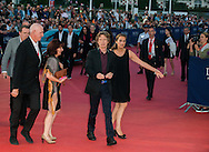Mick Jagger poses on the red carpet as he arrives to attend the Premiere of 'Get on up' during the 40th Deauville American Film Festival on September 12, 2014 in Deauville, France.