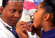 Doctor, Physician at Work, African American Physician and Black Female Child Patient