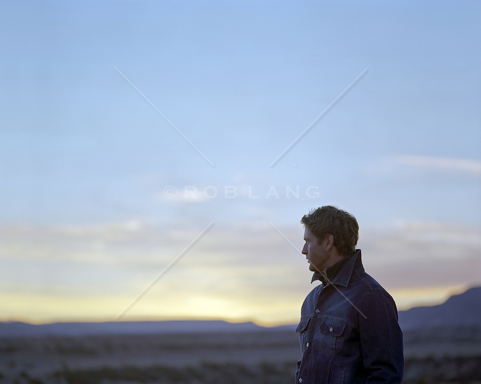 man alone watching the sunset in New Mexico
